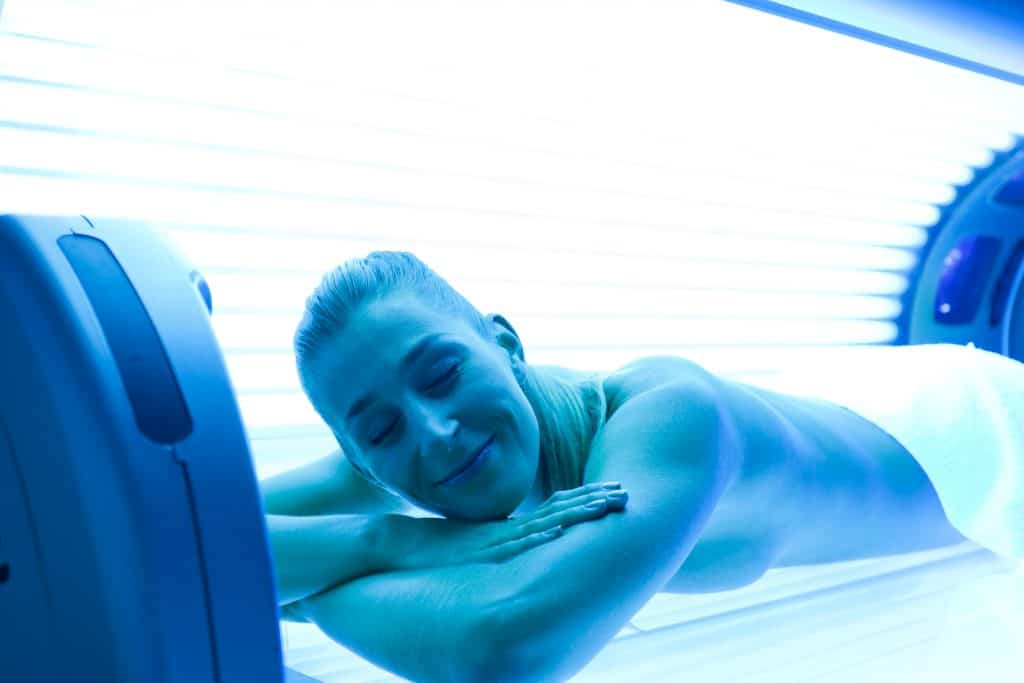Young woman lying on tanning bed for a beautiful complexion