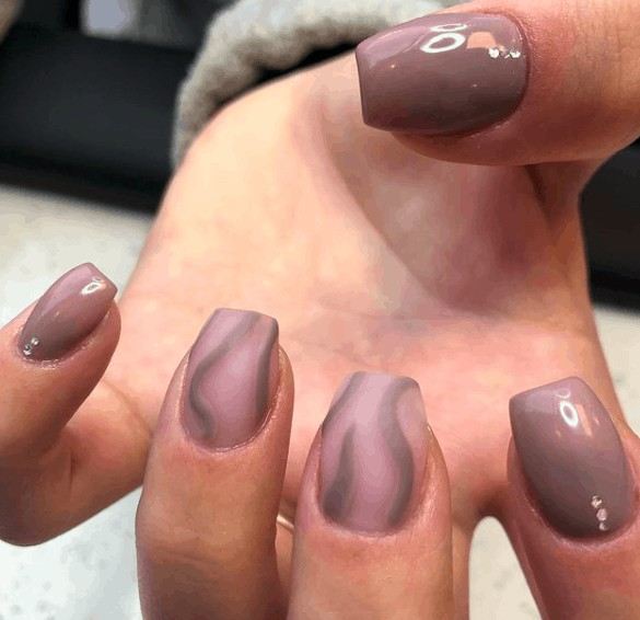 nude nails with touch of gray spirals