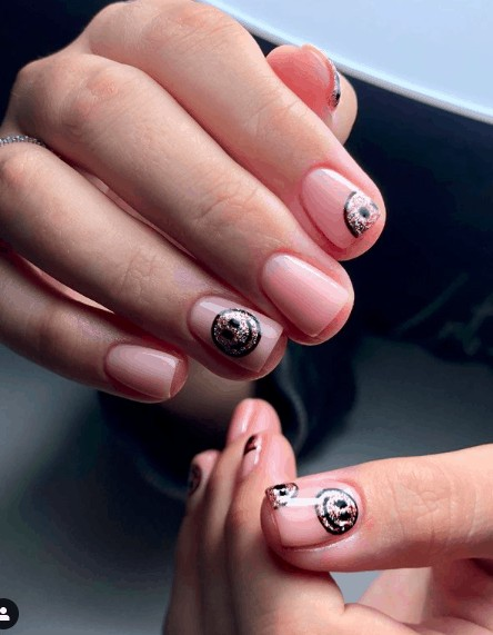 colorless nails with black and gold smiley faces