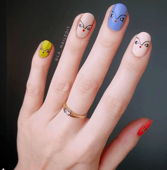different nail colors with face drawing