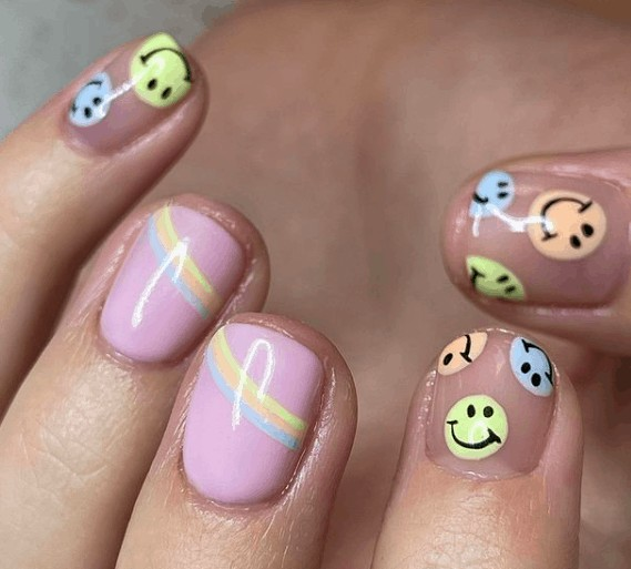 pink nails with smiling face designs