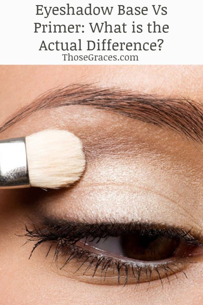 Woman applying sparkly gold eye shadow base with a white makeup brush