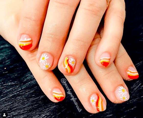 orange and yellow flower indie nail design