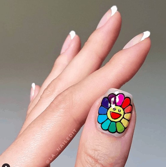 nail design with a colorful flower smiling