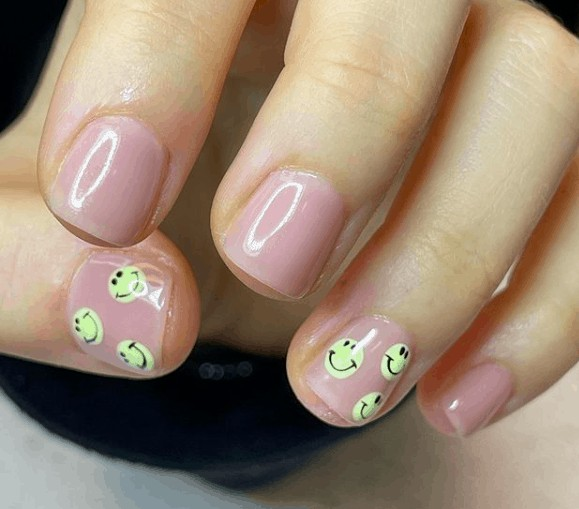 nude pink nails with smiley faces