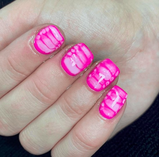 pink indie nail design with touch of white lines