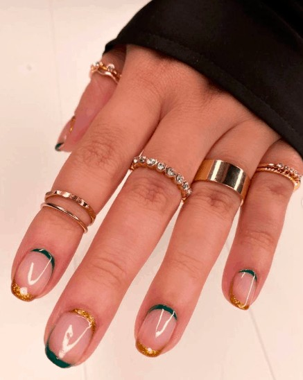 colorless indie nails with gold and blue tip