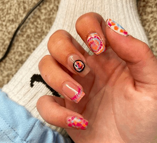 neon nail design with one smiley face in the middle finger