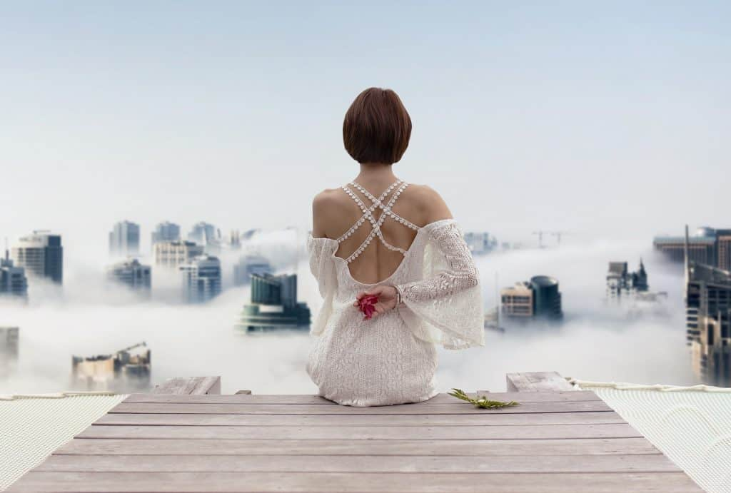 a short hair lady in white backless dress