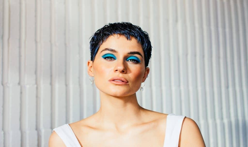 a gorgeous short hair lady with bright blue eyeshadows