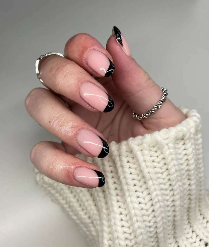 nude pink nail design with black tip