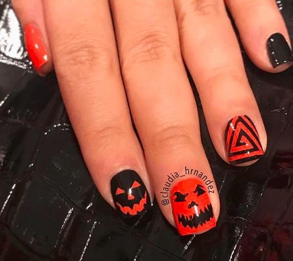 black nails with halloween smiley faces