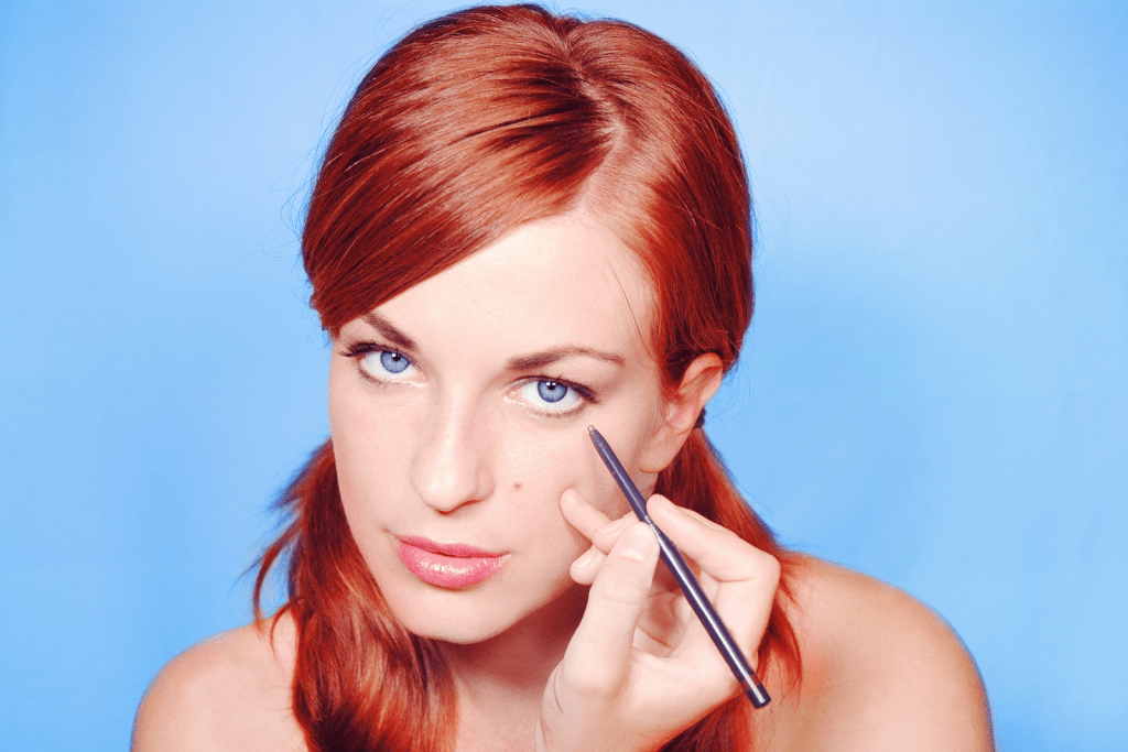 a red-haired lady wearing a white eyeliner