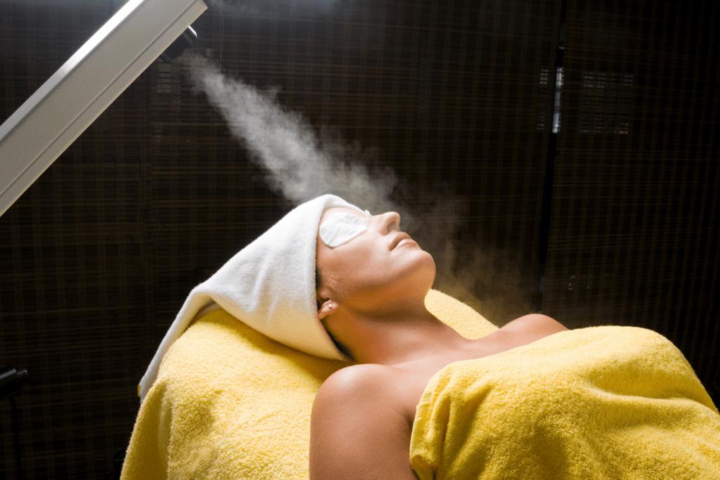 a girl getting a facial steam on a salon