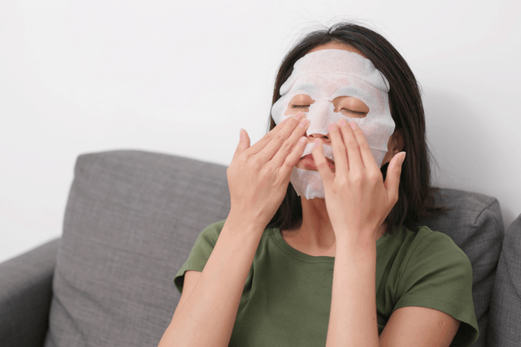 a lady using a face mask for her overnight regimen