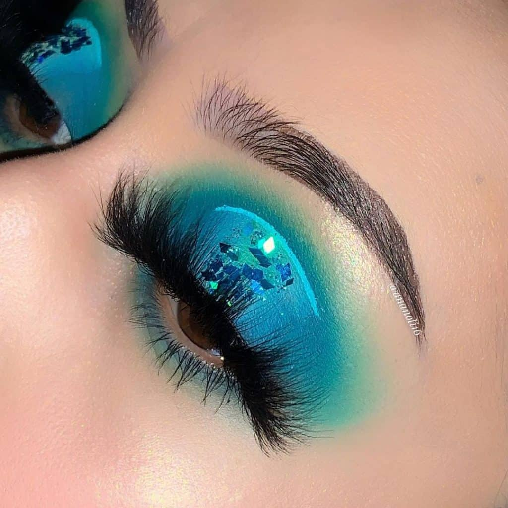 eyes with very bright blue and green eyeshadows for take me back to brazil looks