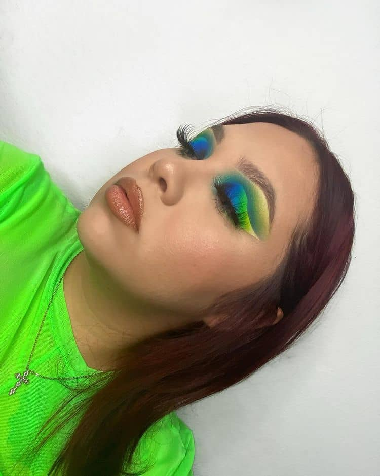 beautiful lady in green with bright green eyeshadows