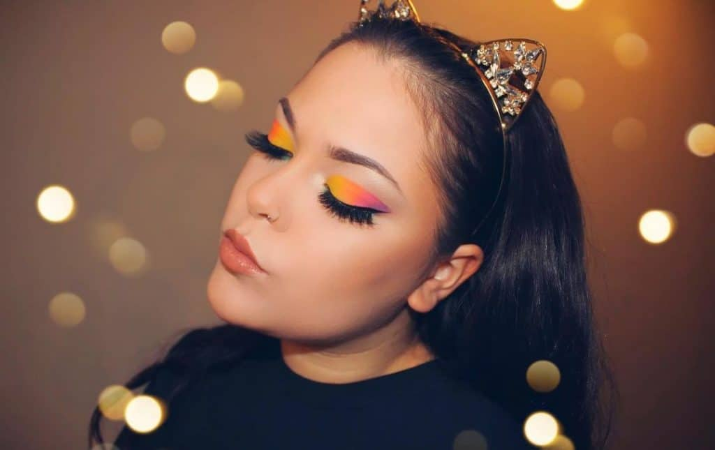 lady with bright eyeshadows with combination of orange and yellow eyeshadows