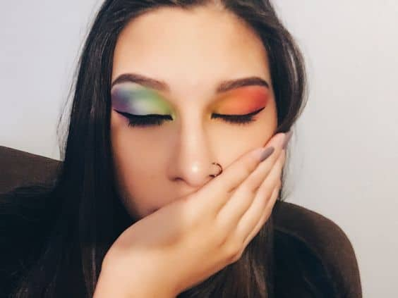 take me back to brazil looks: a beautiful lady with colorful eyeshadows