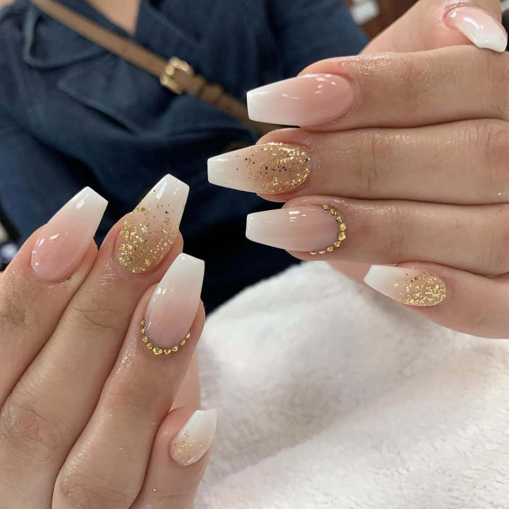 nail design with touch of gold glitters