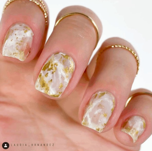 nails with white and gold marble designs