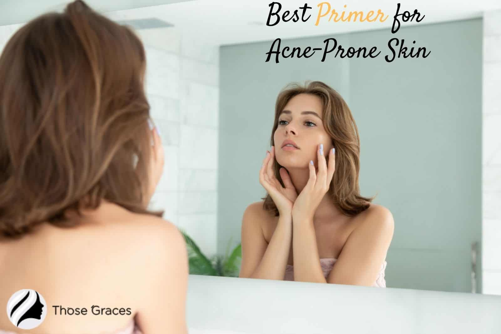 a young lady looking at the mirror after applying the best primer for acne prone skin