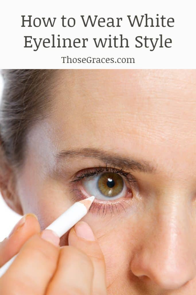 woman applying white eyeliner