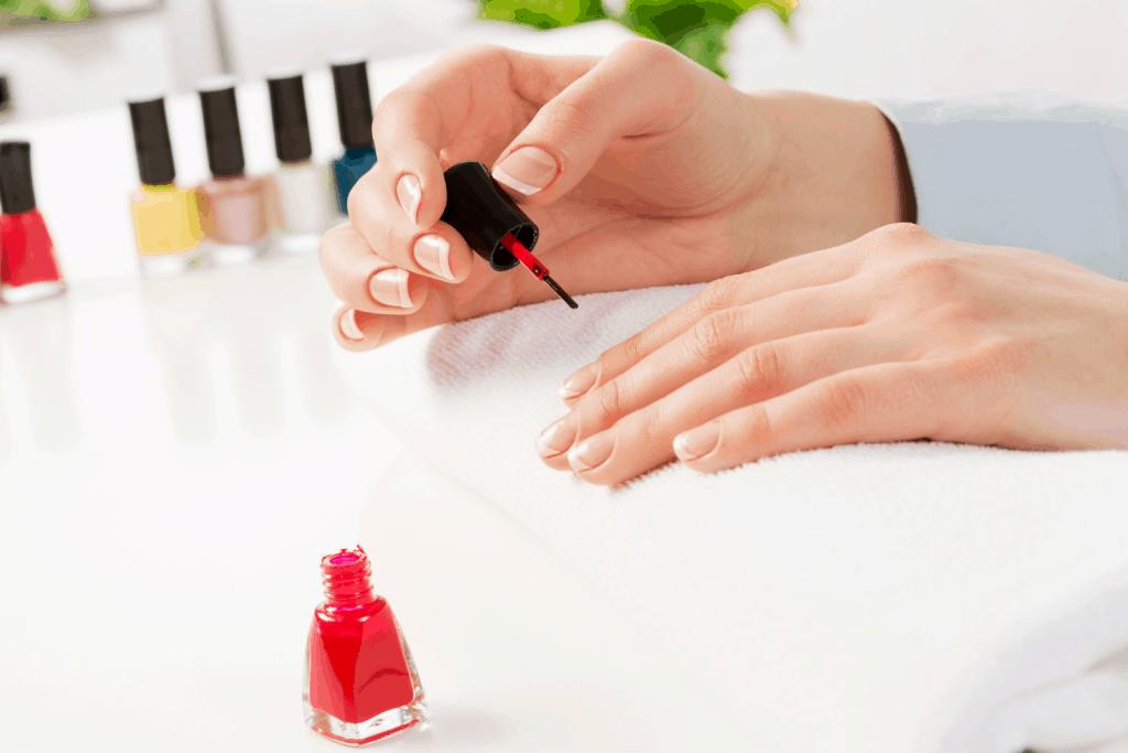 making mandala nail art design using different nail polishes