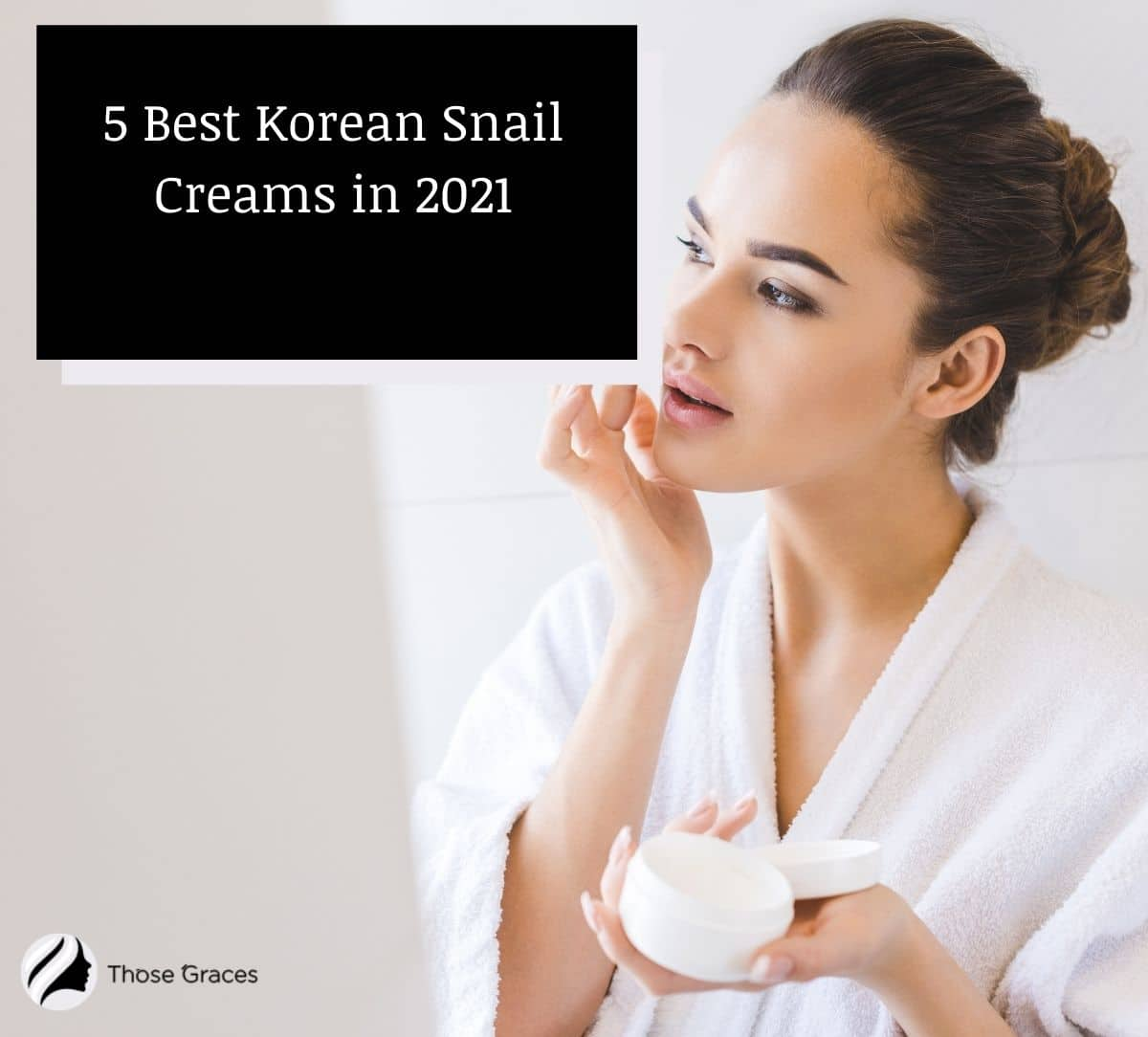 a pretty lady in robe putting a Korean snail cream on her face