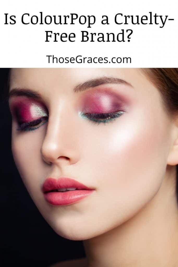woman with colorful eyeshadows and light red lipstick