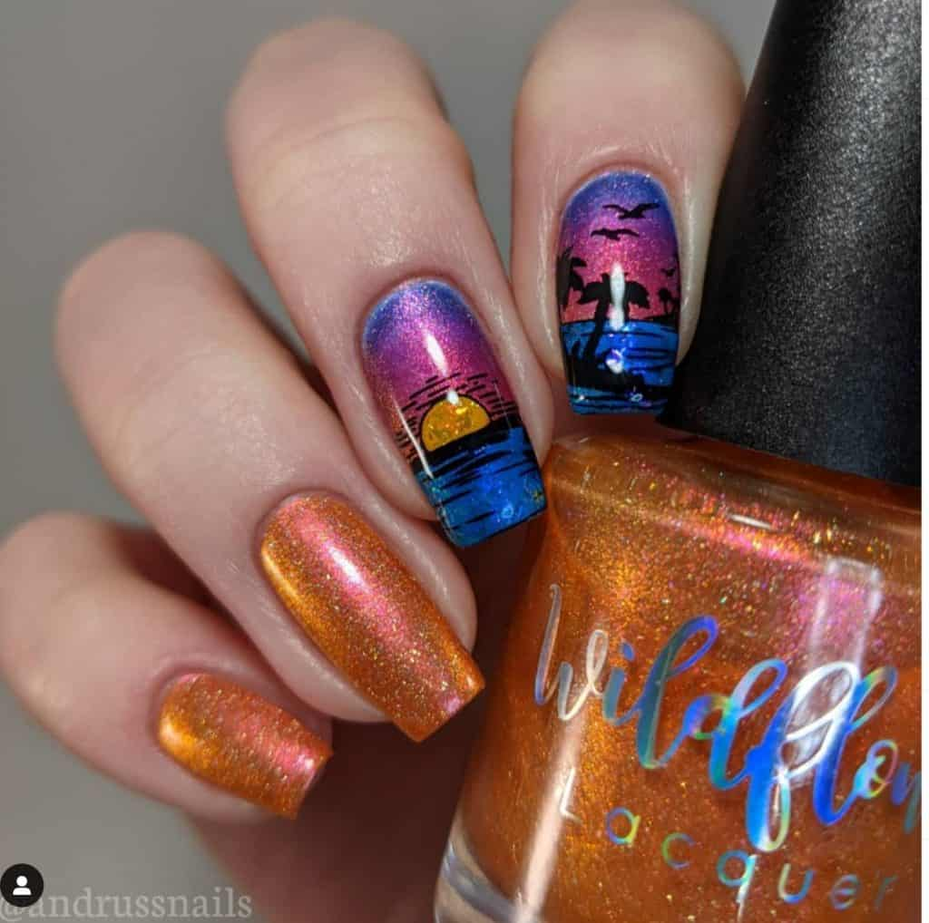 sunset and coconut trees nail design