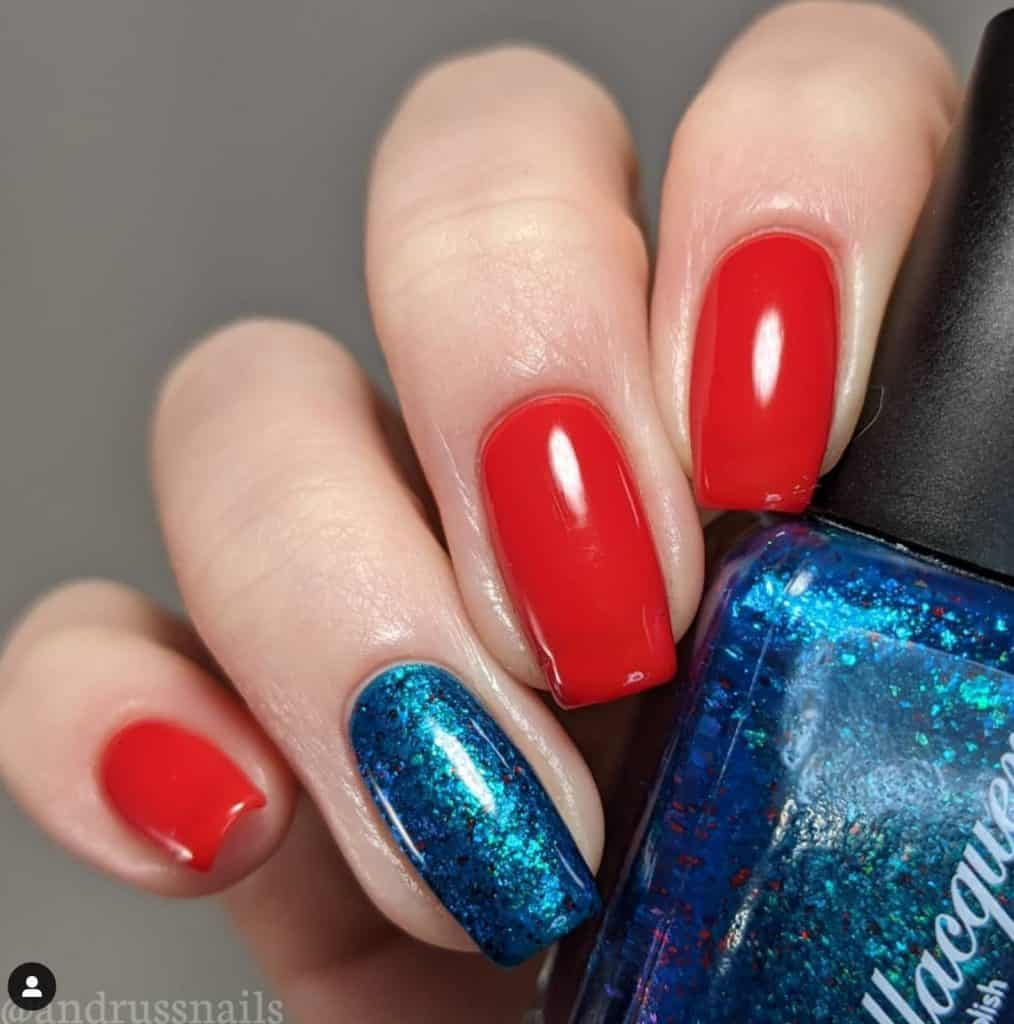 4 red nails and one glittery blue nail