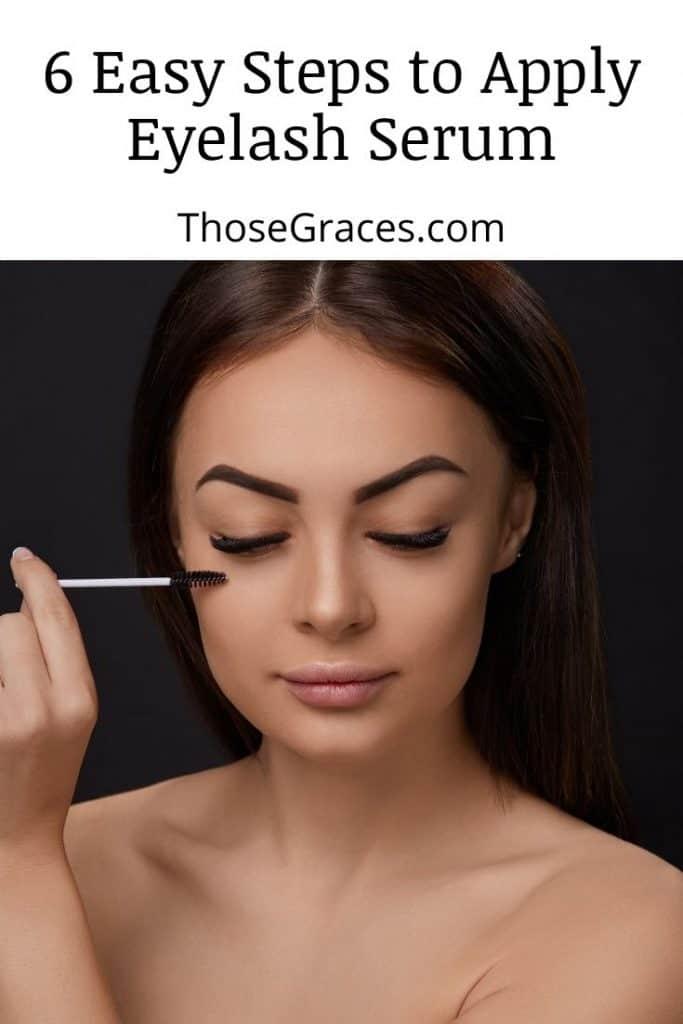 a beautiful woman applying an eyelash serum to her lashes