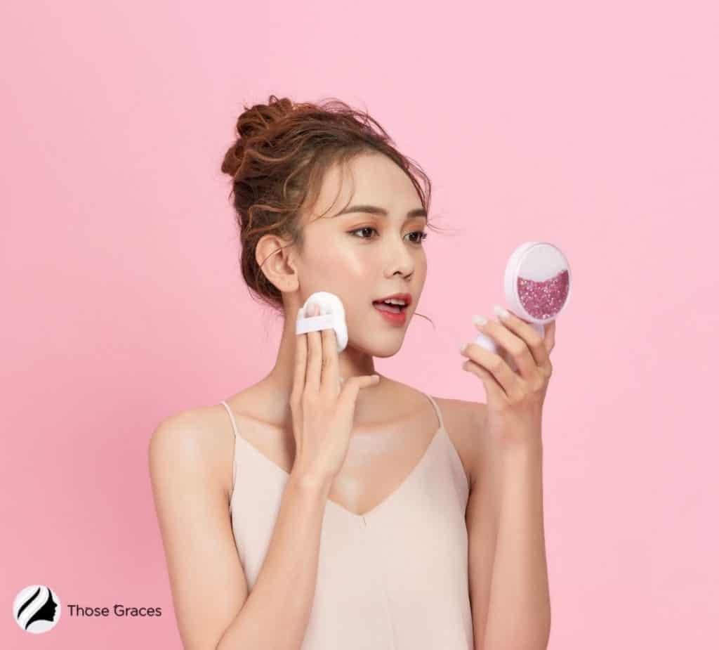 Korean girl putting cushion foundation on her right cheek