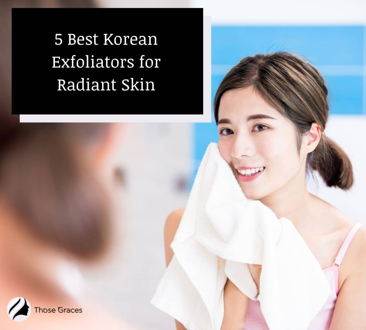 an Asian lady drying her face with a clean towel after using a Korean exfoliator