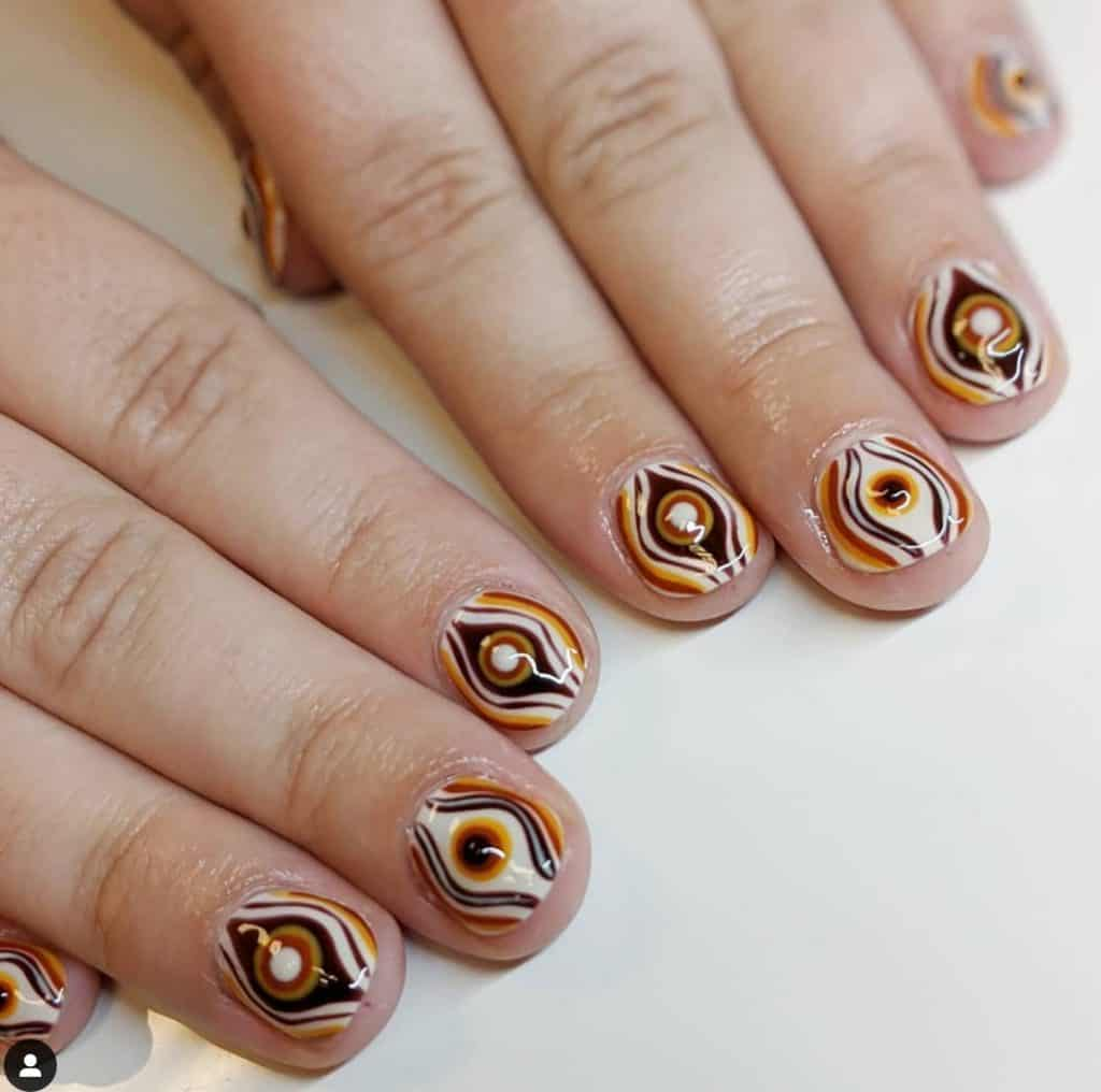 unique nail design with brown and white colors