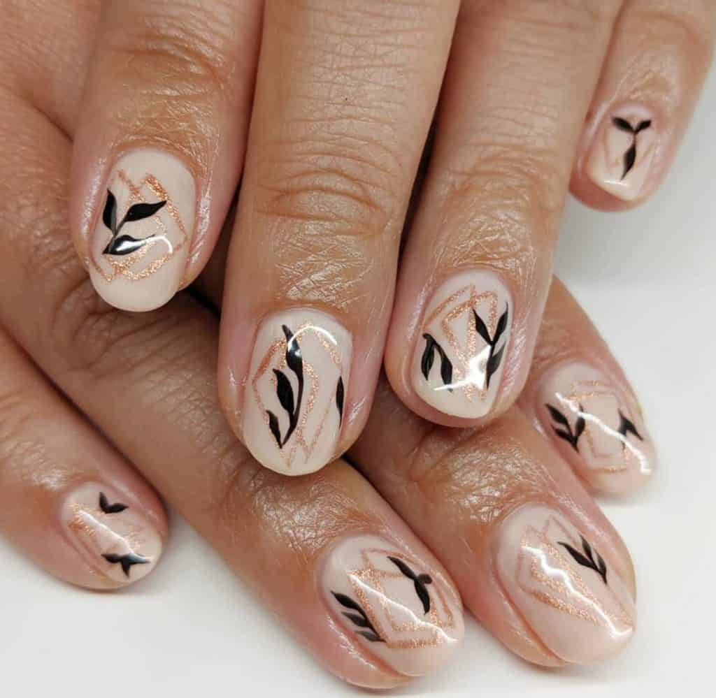nude nail color with black leaves