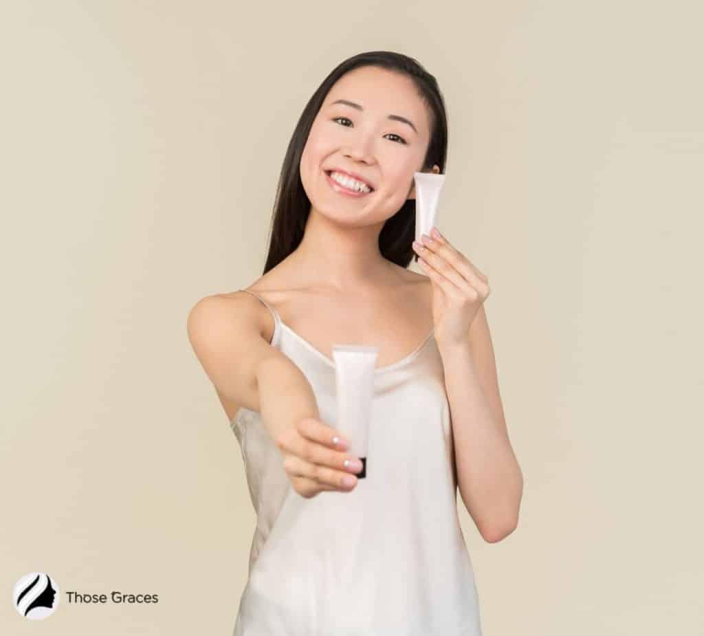 Asian lady holding two Korean BB creams