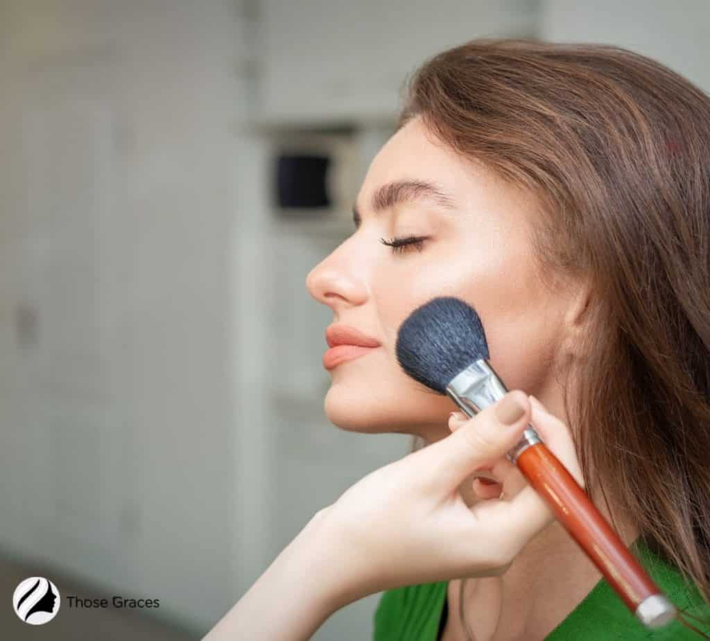 lady putting Korean BB cream on her face using a makeup brush