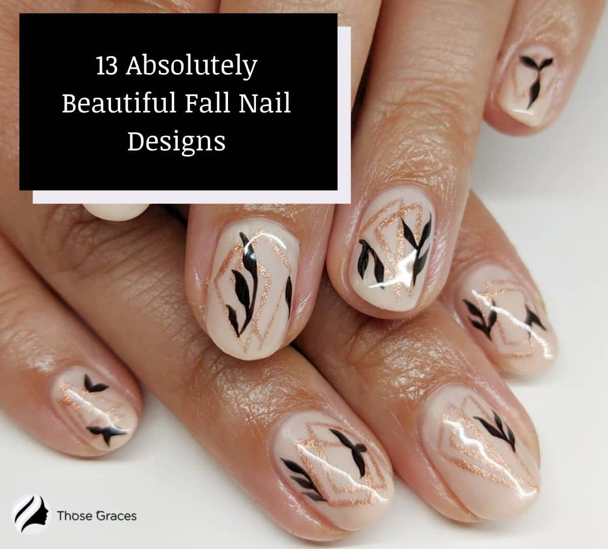 beautiful nails with black and glittery gold leaves design