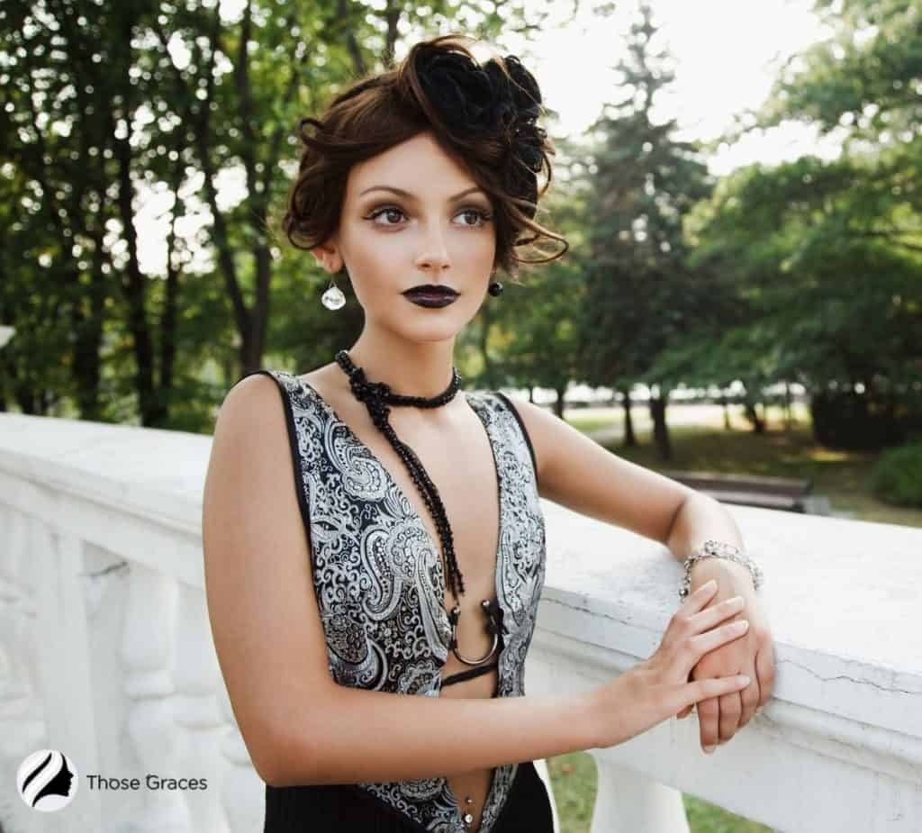 a pretty woman with a goth makeup and sexy top