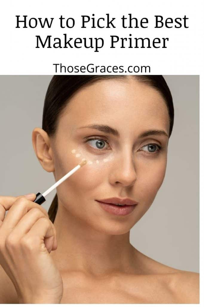 woman putting a makeup primer on her right under eye