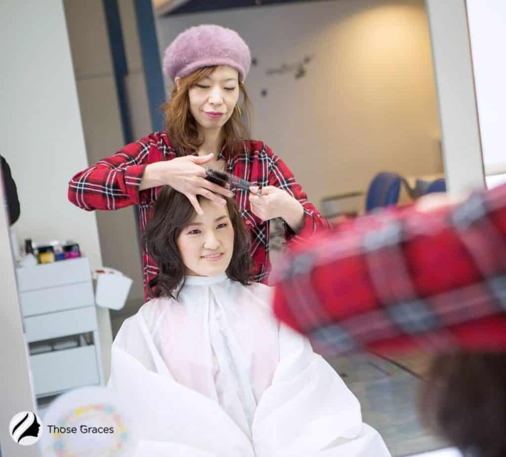 lady having a new haircut in a salon