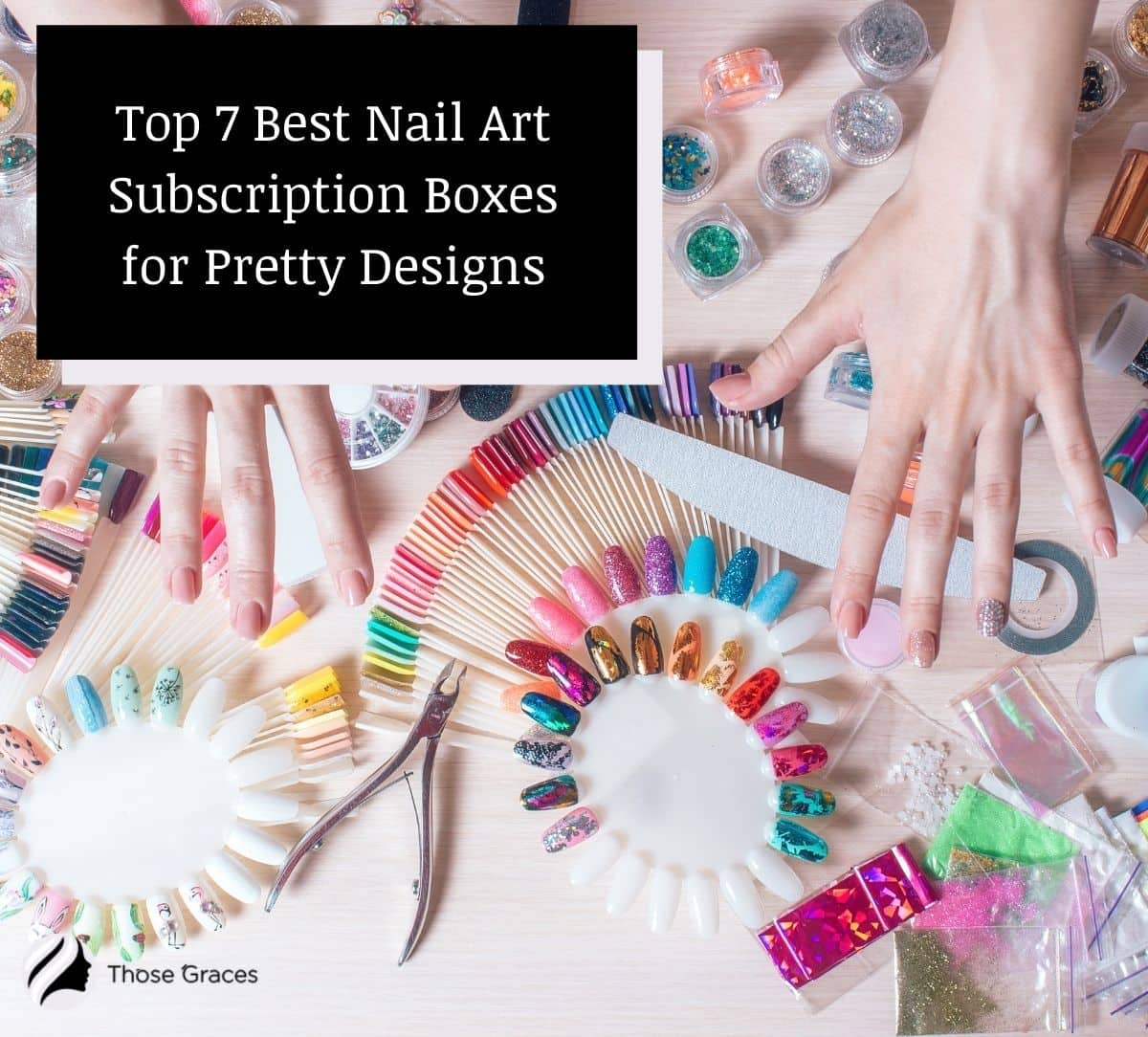 a hand surrounded by several nail art materials from nail art subscription boxes