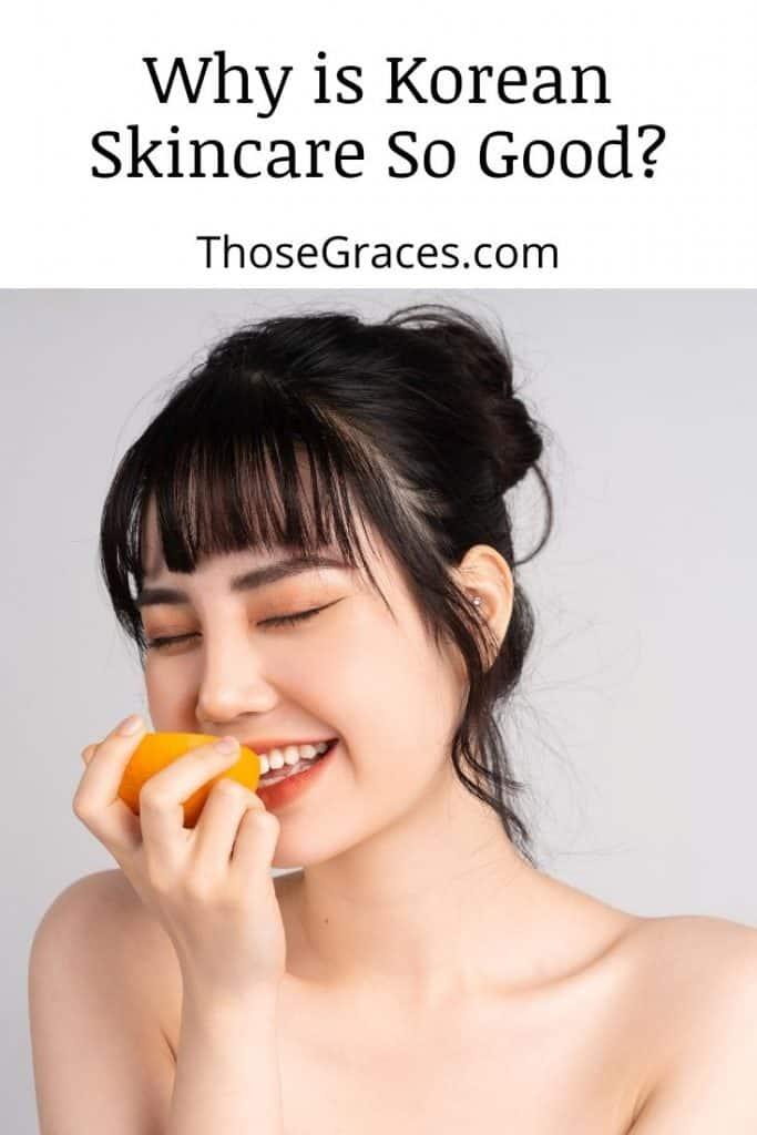 a gorgeous Korean lady eating a fresh orange