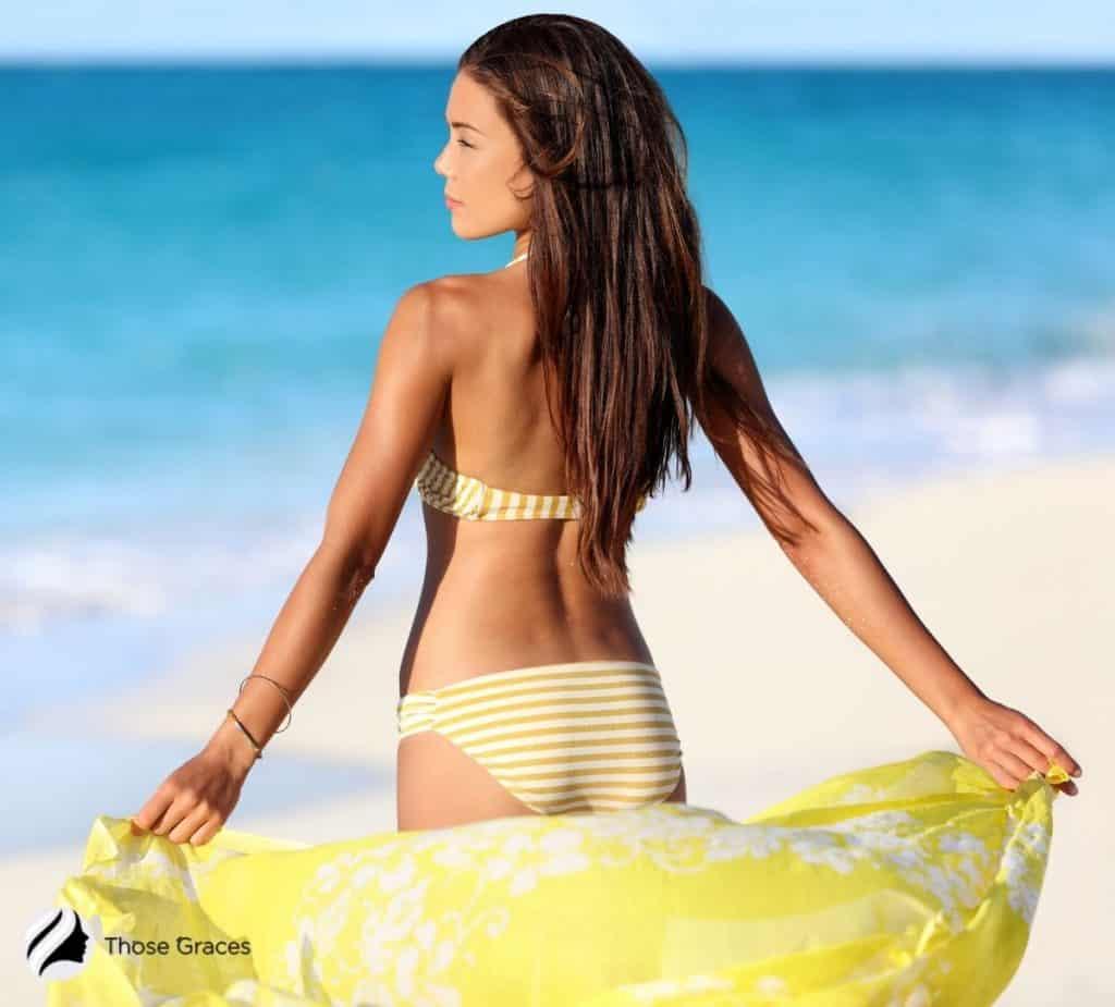 lady in yellow and white bikini