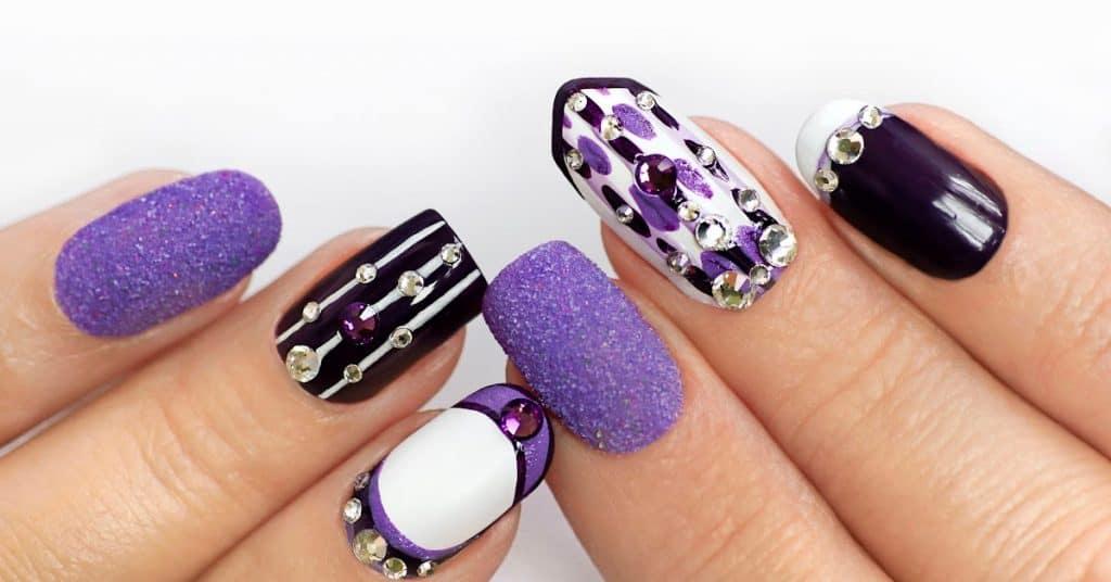 gel nail art with rhinestones