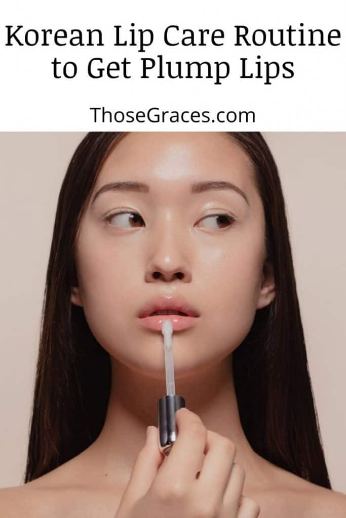 a Korean lady applying lip gloss as part of her Korean lip care routine