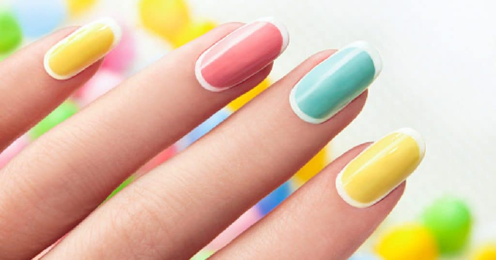 Manicure on an oval shaped nails in pastel colored tone