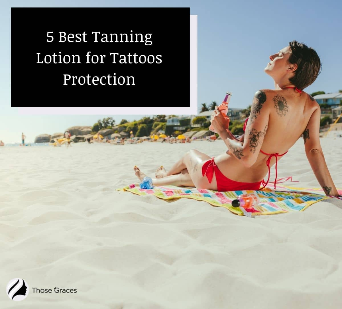 lady with tattoos tanning in the beach while using the best Tanning Lotion for Tattoos
